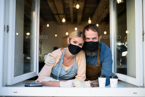 Coffee shop owners with face masks, lockdown, quarantine, coronavirus, back to normal concept - Stock Photo - Images