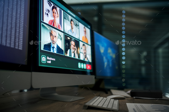 Desk with computers, business call and working late concept - Stock Photo - Images