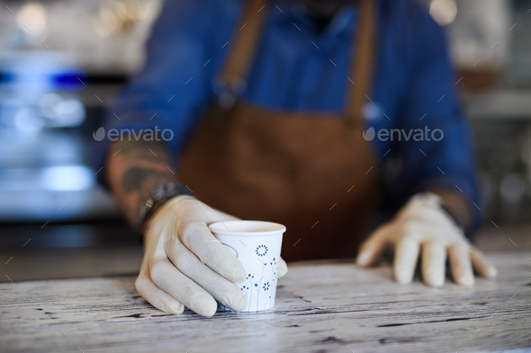 Barista working with gloves, coffee shop open after lockdown quarantine - Stock Photo - Images