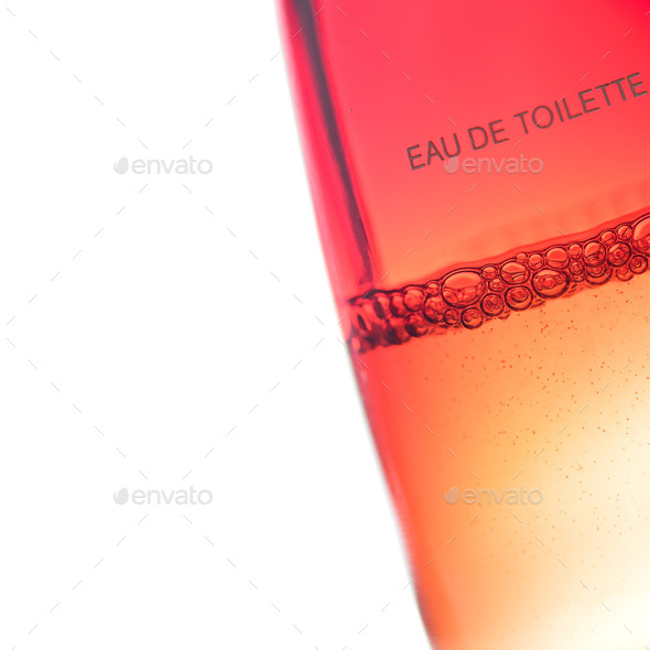 Bubbles in a perfume bottle on a white background - Stock Photo - Images