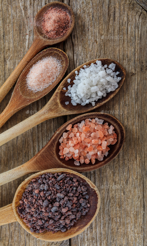 Salts variation crystals and powder in wooden background, - Stock Photo - Images