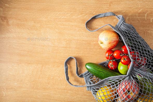 fruits vegetables in reusable mesh cotton bag, plastic free zero waste concept - Stock Photo - Images