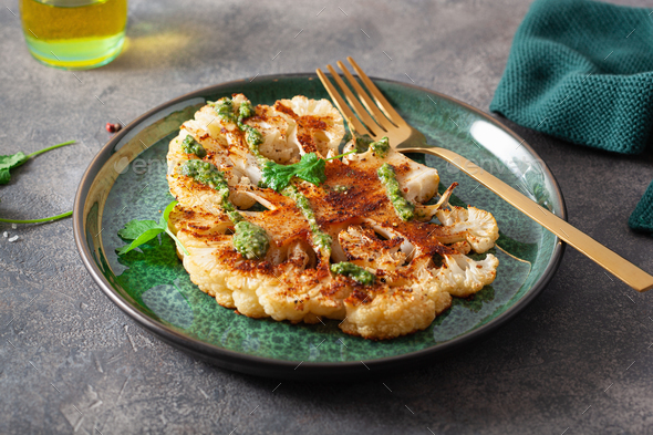 cauliflower steaks with herb sauce and spice. plant based meat substitute - Stock Photo - Images