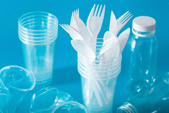 single use plastic cups, forks, spoons. concept of recycling plastic, plastic waste - Stock Photo - Images