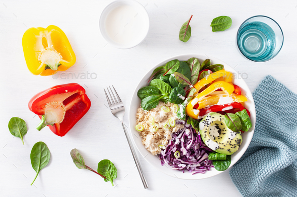 veggie couscous lunch bowl with avocado, bell peppers, spinach and red cabbage - Stock Photo - Images