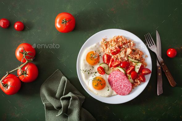 ketogenic paleo diet breakfast. cauliflower rice, fried egg salami - Stock Photo - Images