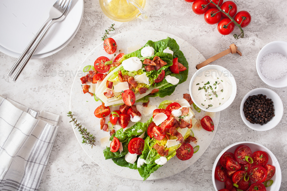 romaine lettuce topped with bacon tomato parmesan, sauce. healthy keto paleo diet lunch - Stock Photo - Images