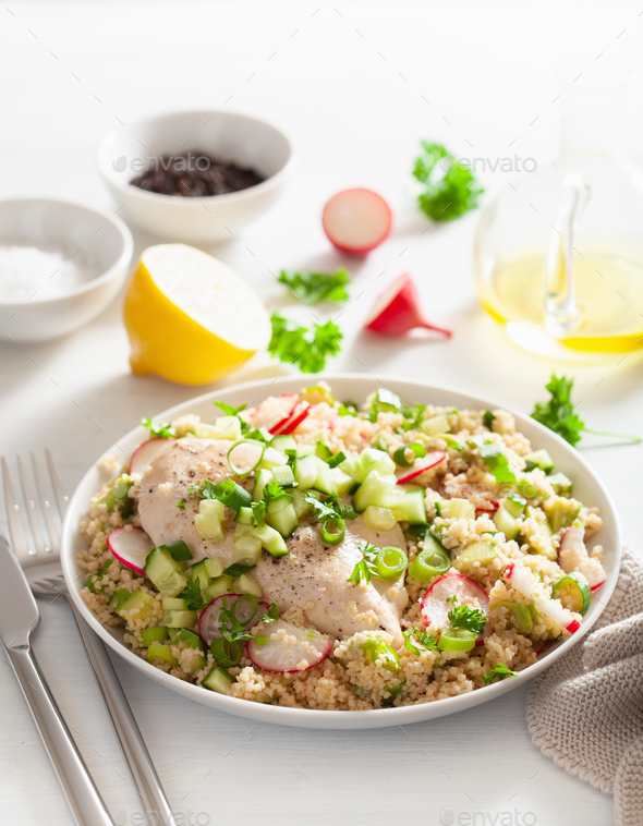 chicken breast with couscous, cucumber, avocado, spring onion, radish. healthy lunch - Stock Photo - Images