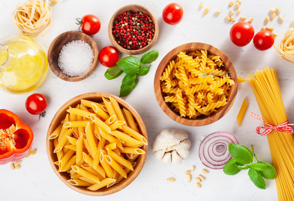 ingredients for italian cousine flat lay, pasta spaghetti penne fusilli tomato oil vegetables - Stock Photo - Images