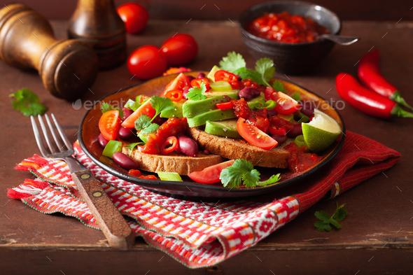 mexican avocado bean sandwich with tomato chili scallion - Stock Photo - Images