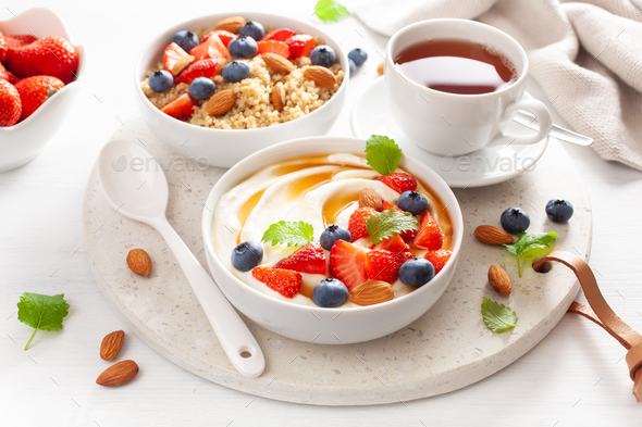 yogurt with strawberry blueberry honey almond and quinoa for breakfast - Stock Photo - Images