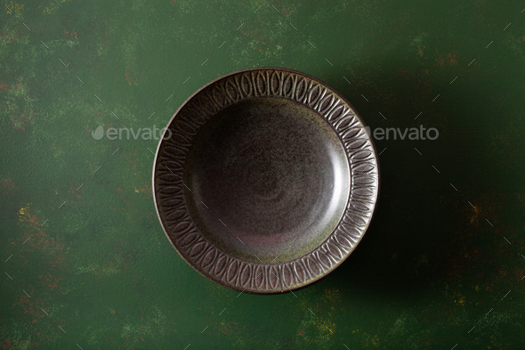 empty plate on dark green background - Stock Photo - Images