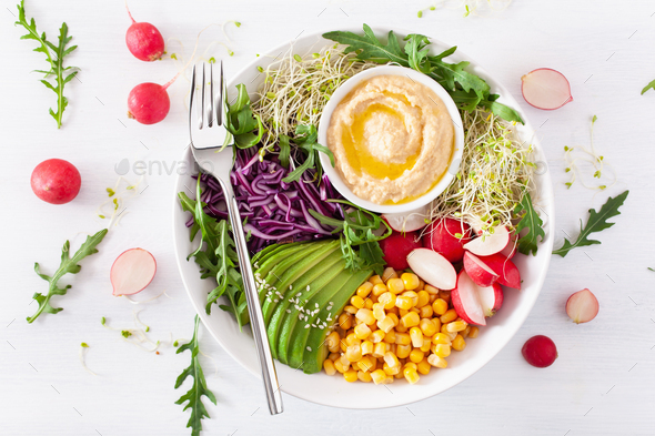 vegan avocado sweet corn lunch bowl with hummus, red cabbage, radish and sprouts - Stock Photo - Images