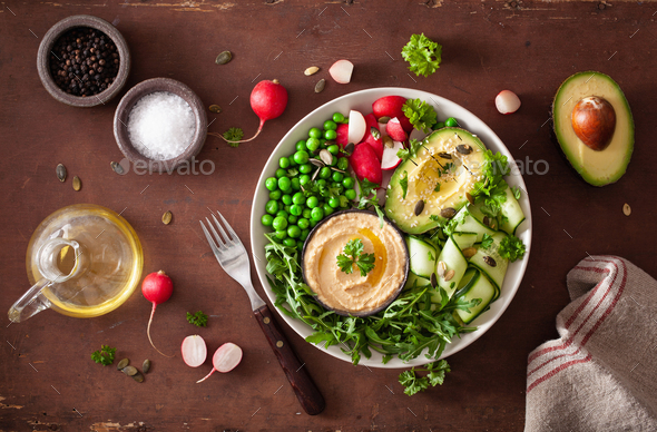 healthy vegan lunch bowl with avocaco cucumber hummus peas radish - Stock Photo - Images