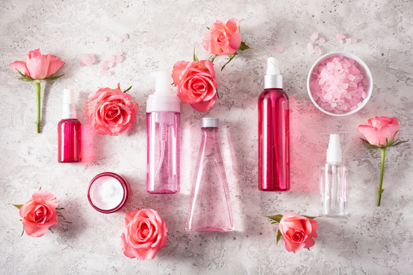 bottles skincare lotion serum medical rose flowers. organic natural cosmetic - Stock Photo - Images