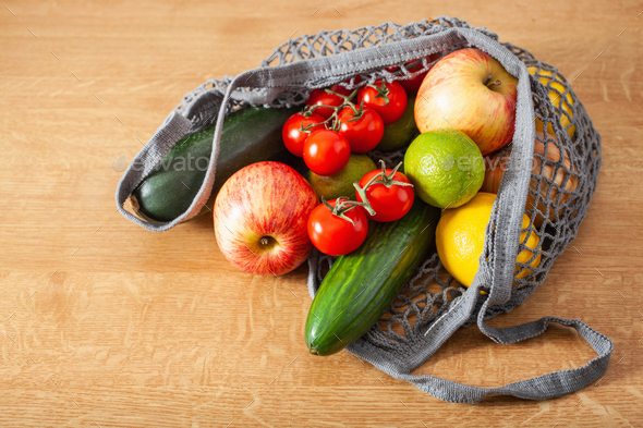fruits vegetables in reusable mesh cotton bag, plastic free zero waste concept - Stock Photo - Images