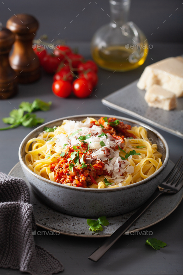 tagliatelle bolognese with herbs and parmesan, italian pasta - Stock Photo - Images