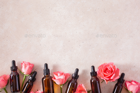 essential oils in bottles rose flowers. alternative medicine aromatherapy - Stock Photo - Images