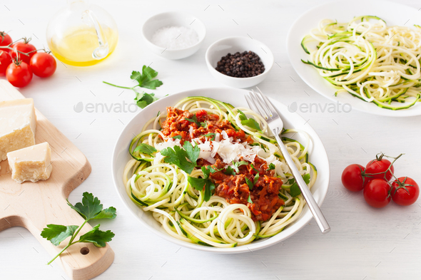 keto paleo zoodles bolognese: zucchini noodles with meat sauce and parmesan - Stock Photo - Images