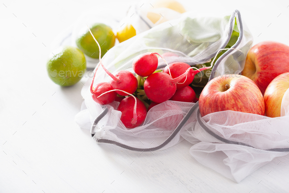 fruits and vegetables in reusable mesh nylon bag, plastic free zero waste concept - Stock Photo - Images