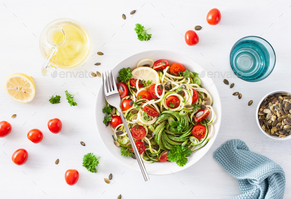 vegan ketogenic spiralized courgette salad with avocado tomato pumpkin seeds - Stock Photo - Images