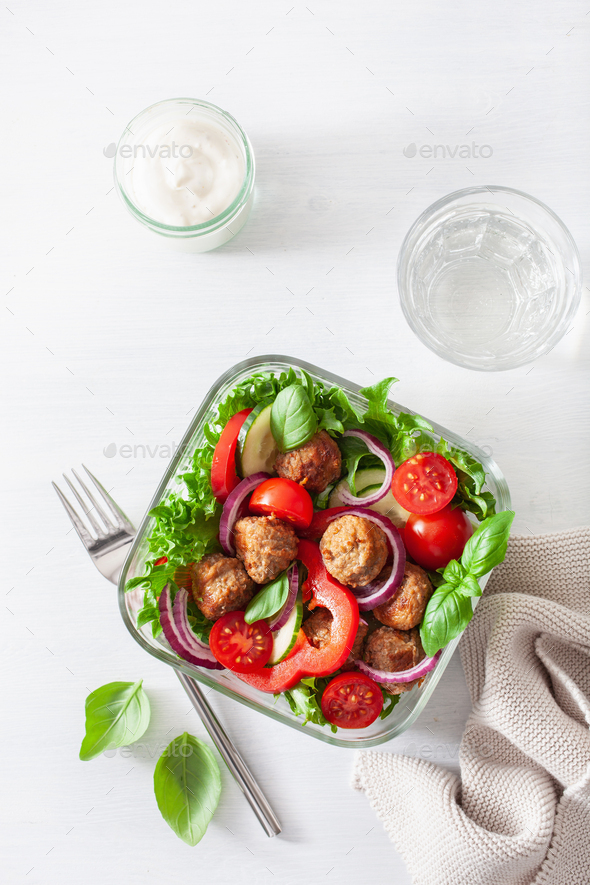 keto paleo lunch box with meatballs, lettuce, tomato, cucumber, bell pepper - Stock Photo - Images
