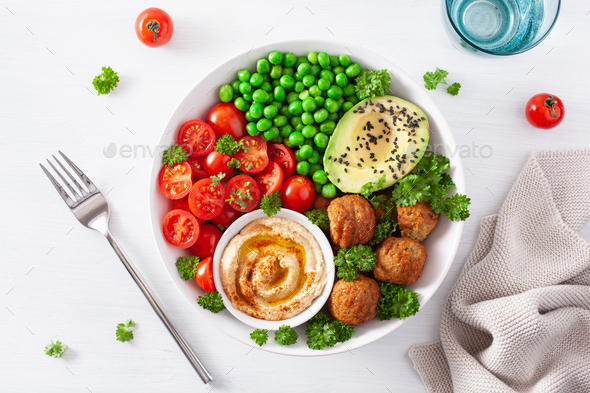 healthy vegan lunch bowl with falafel hummus tomato avocado peas - Stock Photo - Images