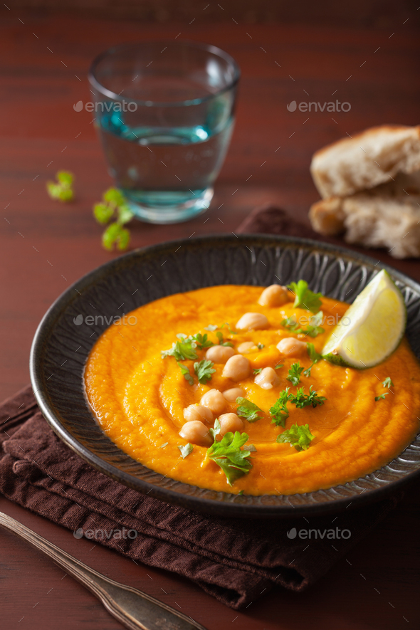 creamy carrot chickpea soup on dark rustic background - Stock Photo - Images