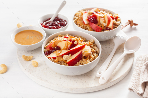 apple peanut butter quinoa bowl with jam and cashew for healthy breakfast - Stock Photo - Images