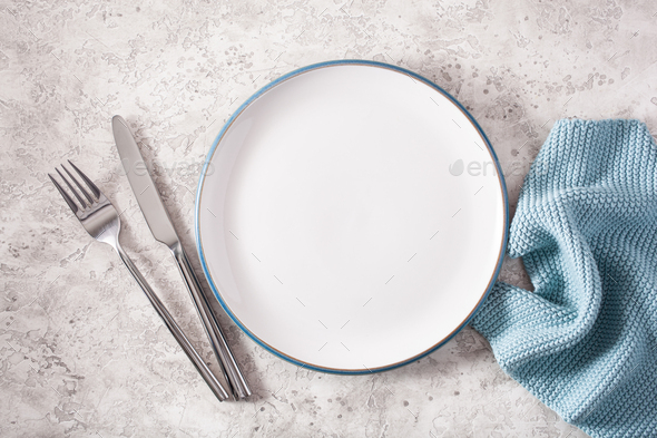 empty plate fork knife on concrete background - Stock Photo - Images