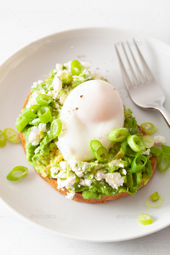 breakfast avocado sandwich with poached egg and feta cheese - Stock Photo - Images