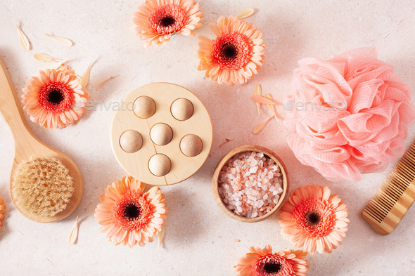 bath and body care products and daisy flowers. natural cosmetics for home spa treatment - Stock Photo - Images