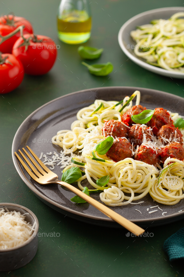 keto paleo diet zoodles spiralized zucchini noodles with meatballs and parmesan - Stock Photo - Images