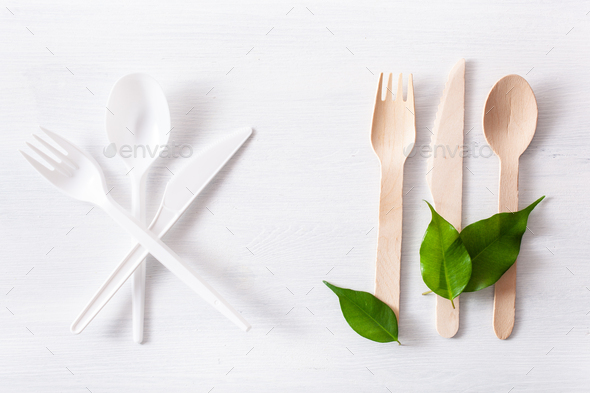 harmful plastic cutlery and eco friendly wooden cutlery. plastic free concept - Stock Photo - Images