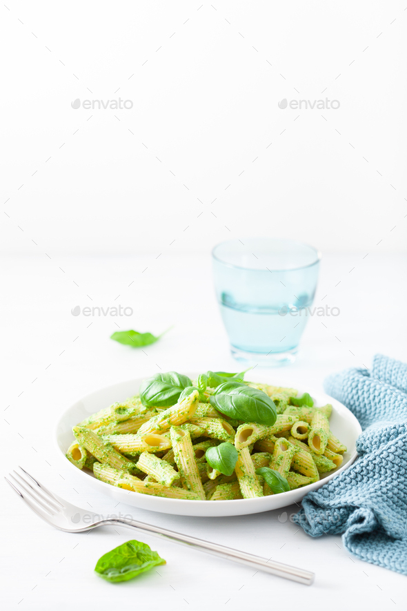 penne pasta with spinach basil pesto sauce - Stock Photo - Images