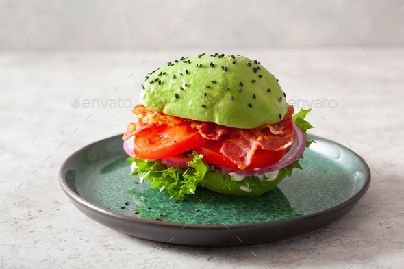 keto paleo diet avocado burger with bacon, lettuce, tomato - Stock Photo - Images