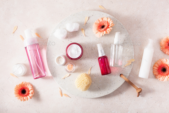 skincare products and daisy flowers. natural cosmetics for home spa treatment - Stock Photo - Images