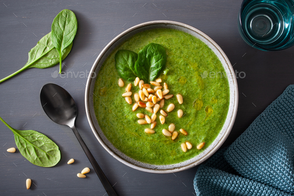 green creamy cauliflower spinach soup on gray background - Stock Photo - Images