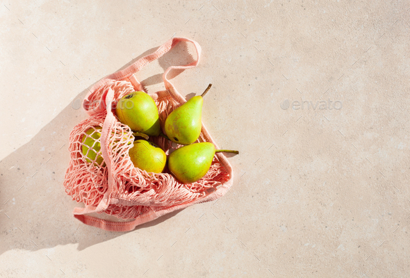 fruits pears in reusable mesh cotton bag, plastic free zero waste concept - Stock Photo - Images