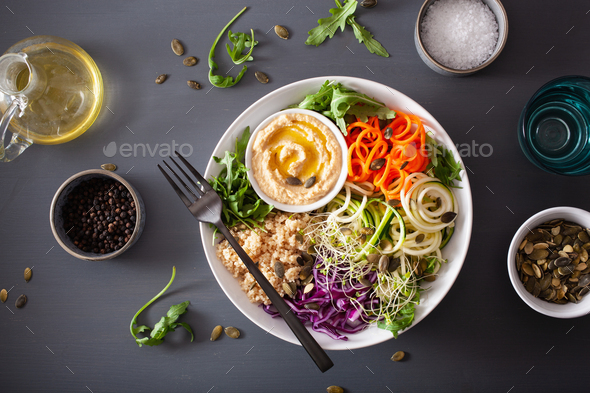veggie couscous lunch bowl with spiralazed carrots and zucchini, hummus and red cabbage - Stock Photo - Images