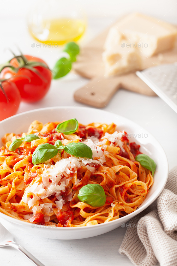 tagliatelle pasta with tomato sauce parmesan basil - Stock Photo - Images