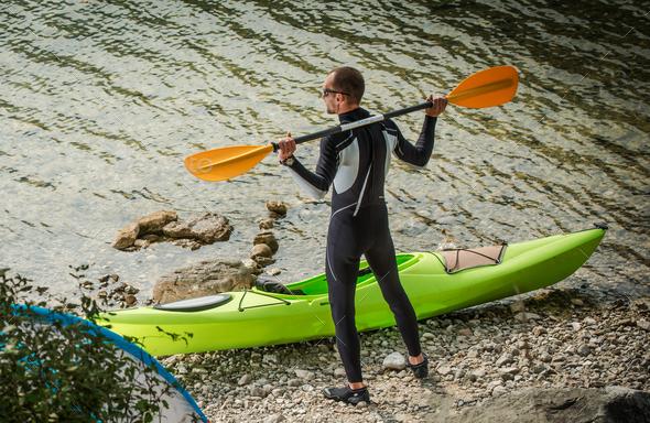 Man By Lake Preparing For Kayaking. - Stock Photo - Images
