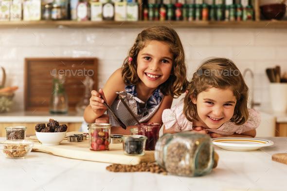 Little sisters girl preparing baking cookies. - Stock Photo - Images