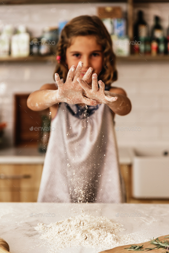 Little child girl kneading dough prepare for baking cookies. - Stock Photo - Images