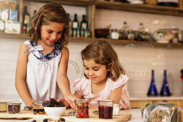 Little sisters girl preparing baking cookies. - Stock Photo - Images