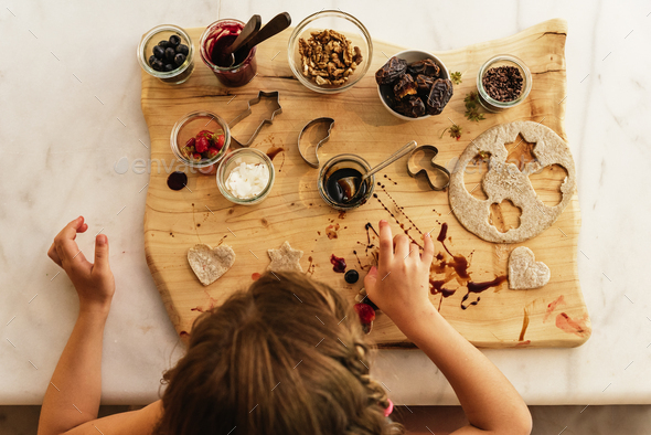 Top view of little girl preparing baking cookies. - Stock Photo - Images