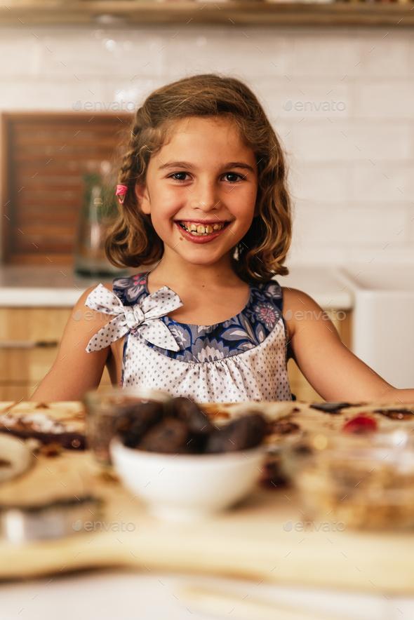 Portrait of little girl preparing baking cookies. - Stock Photo - Images