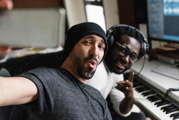 Multiracial artists taking a selfie. - Stock Photo - Images