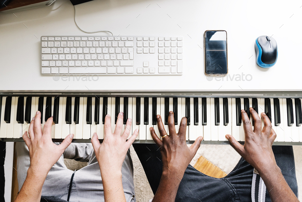 Artists producing music playing the piano. - Stock Photo - Images