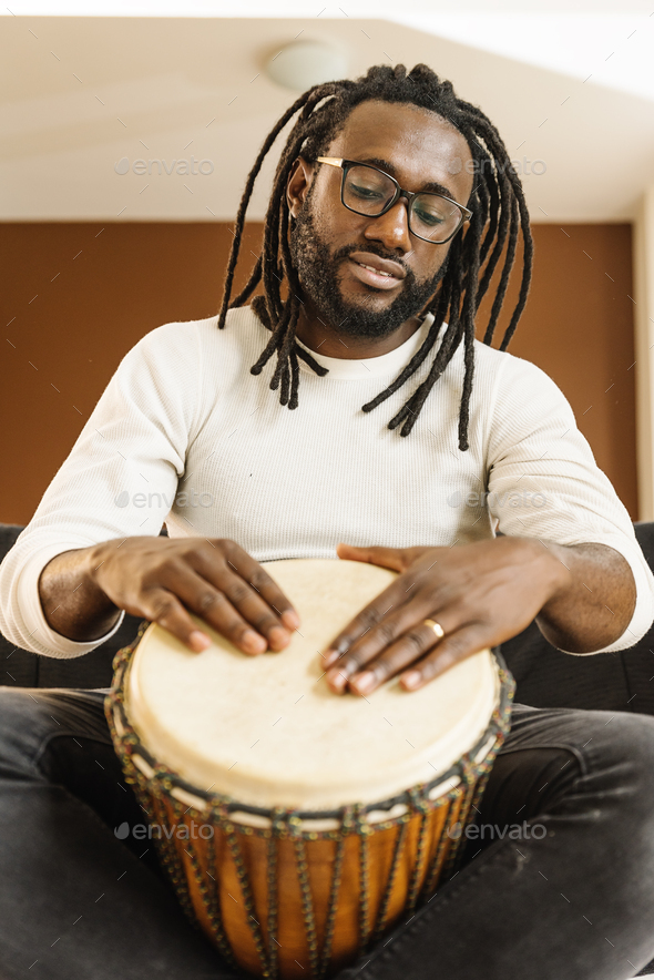 Musician Playing Drum. - Stock Photo - Images